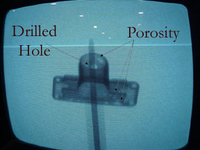 X-ray of original part, showing porosity problems