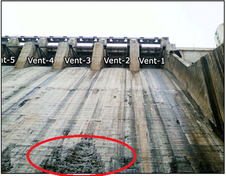 Eroded concrete due to cavitation on the spillway of a dam